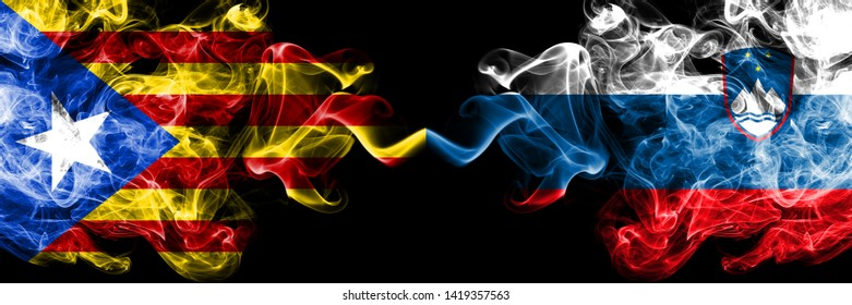 Catalonia vs Slovenia, Slovenian smoke flags placed side by side. Thick colored silky smoke flags of Catalonia and Slovenia, Slovenian