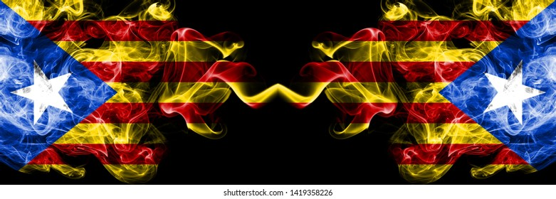 Catalonia vs Catalonia, Spain smoke flags placed side by side. Thick colored silky smoke flags of Catalonia and Catalonia, Spain