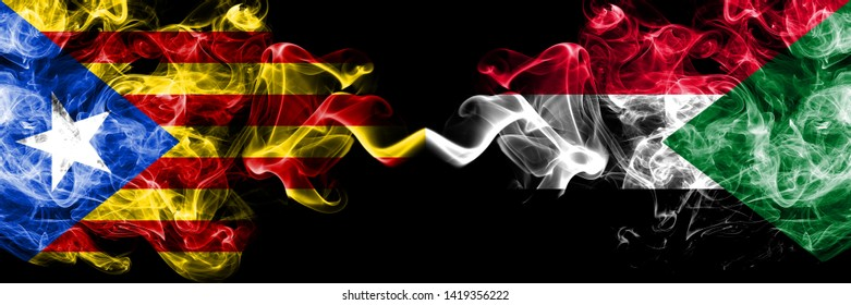 Catalonia vs Sudan, Sudanese smoke flags placed side by side. Thick colored silky smoke flags of Catalonia and Sudan, Sudanese