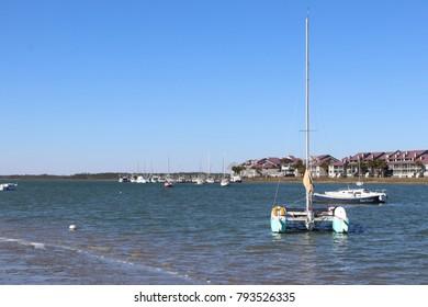 Catamaram Sailboat with Blue Sky