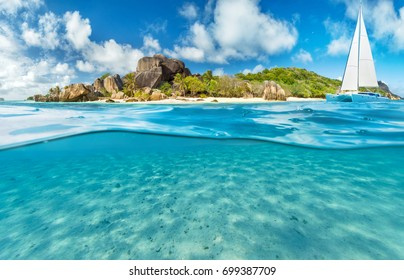Catamaran boat with underwater view. Tropical sea with island, summer beach activities