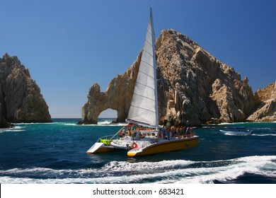 A catamaran at the famous Los Arcos in Cabo San Lucas, Mexico.