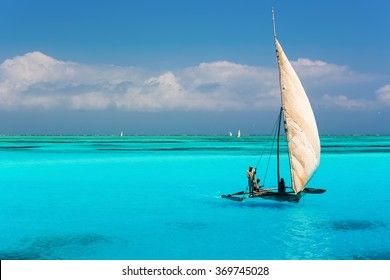 Catamaran on amazing turquoise water in the Indian ocean next to Mnemba atoll, Zanzibar, Tanzania