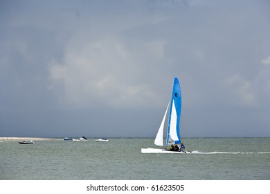 Catamaran on the water, an imminent thunder storm approaching