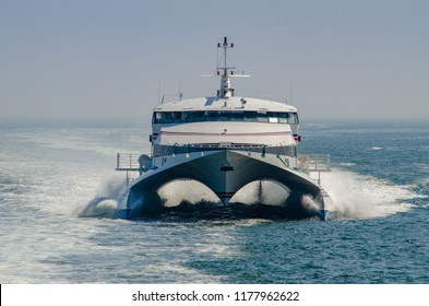 Catamaran passenger ferry approaching the mouth of the New London Harbor in Connecticut.