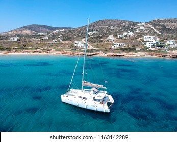 Catamaran sailing in  blue, turquoise water in Greece, beautiful catamaran next to the coast during summer holiday