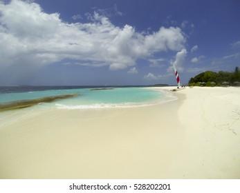 A catamaran sits on a lagoon, Maldives