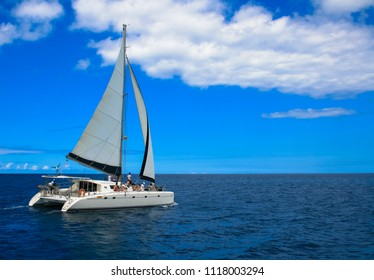 A catamaran with some tourists sailing the Indian ocean.