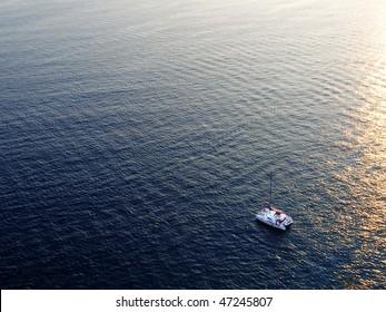 catamaran yacht on sea at sunset