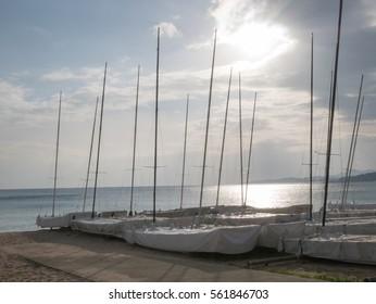 Catamarans on the beach, sailing club waiting for season