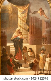 CATANIA, ITALY - APRIL 8, 2018: The painting of Madonna with the children in the church Chiesa di Sant'Agata la Vetere by Giuseppe Sciuti (1898).