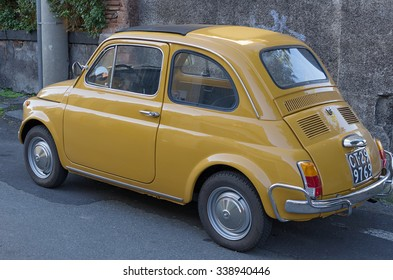 CATANIA, ITALY - DECEMBER 28 2013: a Fiat 500 parked in the city of Catania. The Fiat 500 was a city car produced by the Italian manufacturer Fiat between 1957 and 1975.