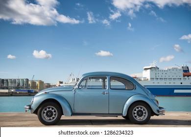 CATANIA, ITALY - January 06 2019: The Volkswagen brand car model beetle appears on a quay near the city of Catania, Sicily, Italy at JANUARY 06, 2019