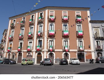 CATANIA, ITALY - JUNE 19 - A building displays the Italian flag on each balcony during celebrations to honor saints S Francesco Di Paola and S Gaetano alla Marina on June 19, 2014 in Catania, Italy.