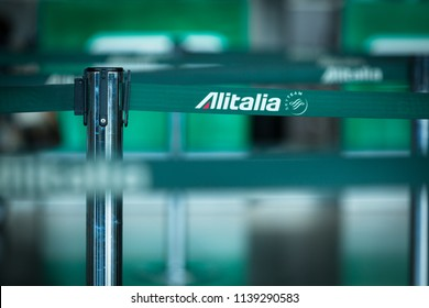 Catania, Italy - June 23 2018: The Logo of the Italian Airline Alitalia printed on a Gate Area Stanchion Belt