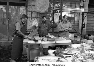 Catania, Italy - October 23, 2015: Fisherman selling swordfish to the fish market in Catania, Italy.  the historic fish market of Catania is today one of the tourist attractions of the city,