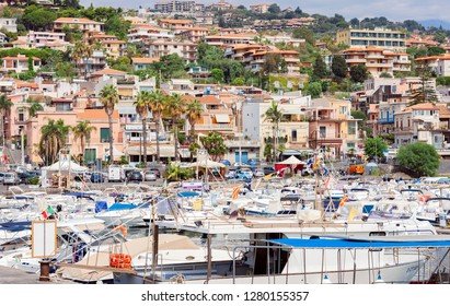 Catania, Sicily, Italy – august 08, 2018: View of Acitrezza port with fisher boats next to Cyclops islands, beautiful cityscape