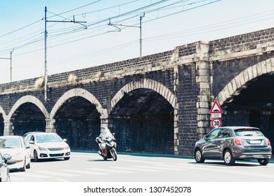 Catania, Sicily, Italy – august 16, 2018: Old stone port bridge Archi della Marina