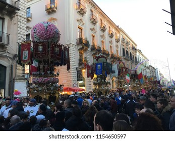 Catania Sicily Italy. Feb 2018 - People participating the Saint Agata's celebrations and procession and carrying votive candles.