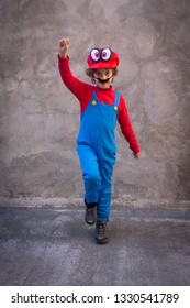 Catania, Sicily/Italy - March/05/2019: Children goes crazy for Super Mario Bros a Nintendo console character. Kid dressing the Super Mario Character uniform.