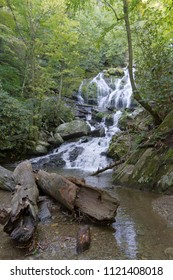 Catawba Falls, one of Western North Carolina's scenic Blue Ridge Mountains waterfalls, cascades over 100 ft onto rocks and logs and can be found at the end of a popular hiking trail in Old Fort, NC