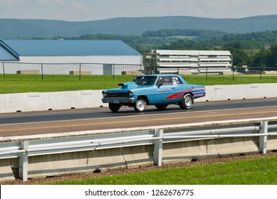"""Catawissa, PA / USA - August 5, 2018: The Bob Rumbel """"Daddy's Toy Daughter's Joy"""" race car competes during a heat at NRHA's Numidia Dragway."""