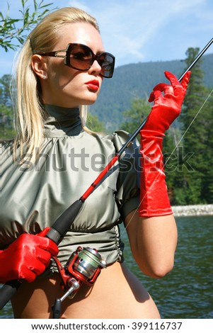 9c9baa201d0fb To catch fish in the beautiful mountain river the young girl of blonde type