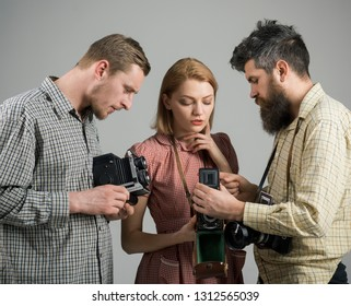 Catch the moment. Photography studio. Group of photographers with retro cameras. Paparazzi or photojournalists with vintage old cameras. Retro style woman and men hold analog photo cameras.