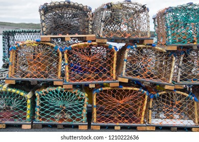 Catch pots stacked on the quayside