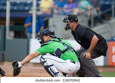 Catcher  and Umpire on the field, MILB Gwinnett Stripers host Norfolk Tides on May 11th 2018 at the Coolray Field Baseball field in gwinnett County Georgia -USA