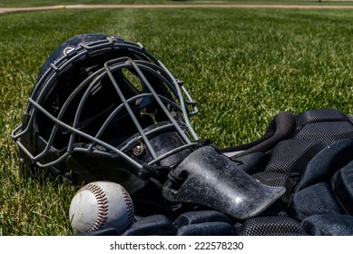 Catcher's Gear on the green grass
