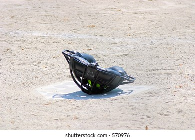 Catcher's mask on home plate