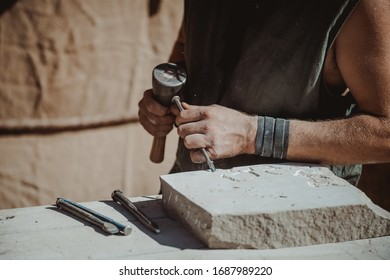 catching craftsman working in craft trade during the medieval days held in the city of Avila, Spain, during the month of September 2019