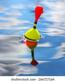 Catching of fish. Fishing bobber on the water.