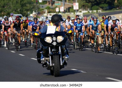 Category racers led out by motorcycle at the Golden Empire Classic bicycle race, June 10, 2007, Bakersfield, CA