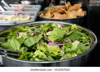 Catered event has traditional Mexican taco makings with a choice of lettus salad as an appetizer or main coarse.
