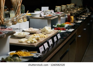 Catering buffet food in hotel restaurant, close-up. Restaurant table with snacks food at event, indoors. Cuisine Culinary Buffet Dinner Catering Dining Food Celebration Party Concept