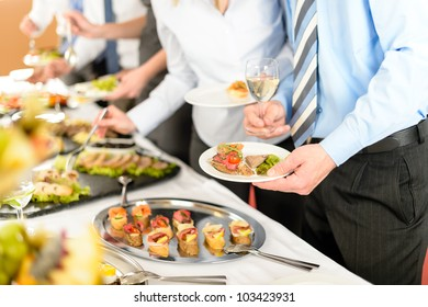 Catering at business company event people choosing buffet food appetizers