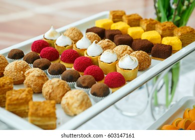Catering. Cakes and pies on white tables