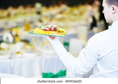 catering event service. Waiter hand with food