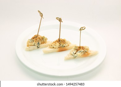 Catering. Fish and bread appetizers/starters on the plate
