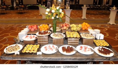 Catering food buffet table with cold snacks, mini sandwiches, pastry, meat and salads. Delicious appetizers on the table, self service