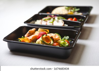 Catering food with healthy balanced diet delicious lunch box gastronomy boxed take away deliver packed ready meal in black container restaurant inn dinner, meal, brakfast - Shutterstock ID 1674683434