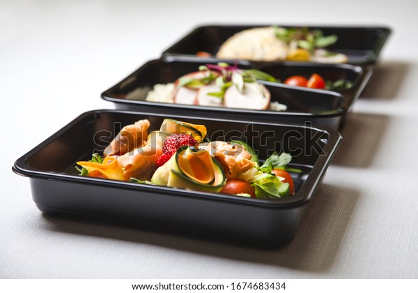 Catering food with healthy balanced diet delicious lunch box gastronomy boxed take away deliver packed ready meal in black container restaurant inn dinner, meal, brakfast