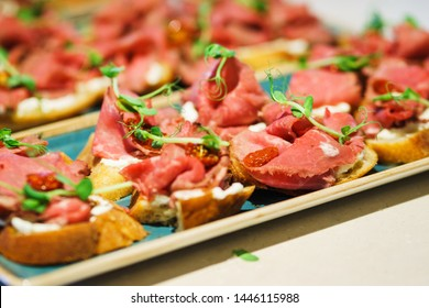 Catering and guest meals during the event. Quick mini snacks in a special beautiful dish. Light meals, tapas on the table in the restaurant.