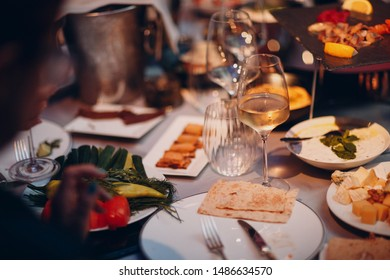 Catering and haute cuisine concept. Snacks, waiter, food.