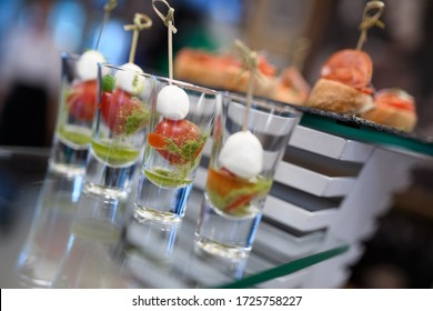 Catering - mozzarella with tomatoes in a glass and pesto sauce