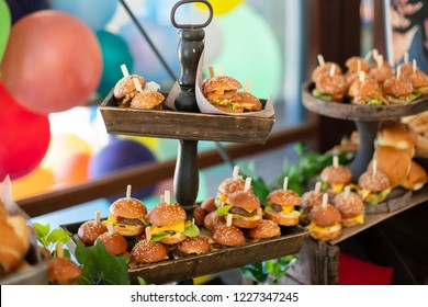 Catering on a party with small delicious cheeseburgers