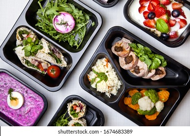 Catering restaurant food with healthy balanced diet delicious lunch box boxed take away deliver packed ready  meal in black container dinner, meal, brakfast fit box