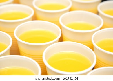 Catering served juice in plastic glasses